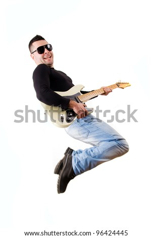 casual man playing an electric guitar and jumping
