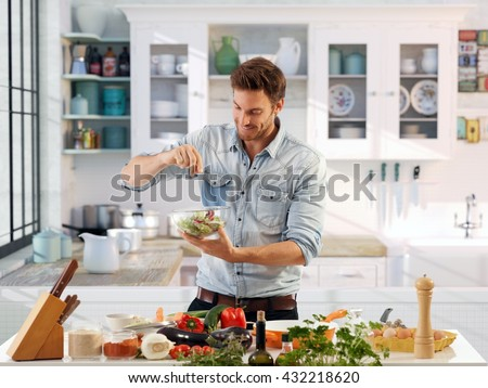 Casual man preparing salad at home in kitchen. - stock photo