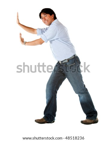 casual man pushing something isolated over a white background