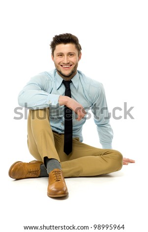 Casual man sitting - stock photo