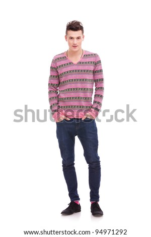 casual man standing isolated over a white background . full body picture of a young man with his hands in his pockets