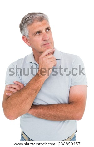 Casual man thinking with hand on chin on white background