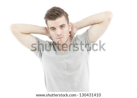 Casual man thinking with his blank gray t-shirt isolated on white background