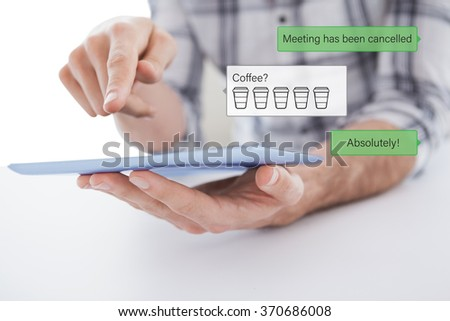 Casual man using tablet pc against smartphone text messaging - stock photo
