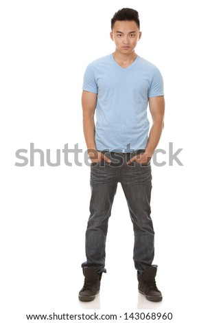 casual man wearing blue tshirt and jeans on white background - stock photo