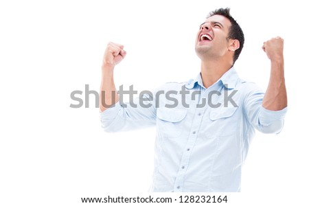 Casual man winning and celebrating - isolated over white - stock photo