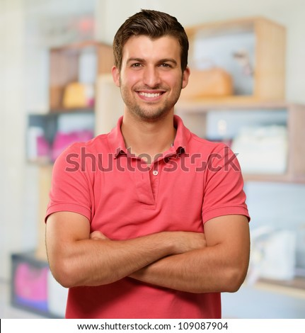 Casual Man with Arms Crossed, indoor - stock photo