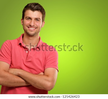 Casual Man with Arms Crossed isolated on green background