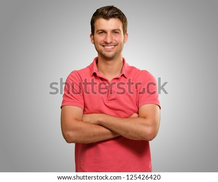 Casual Man with Arms Crossed isolated on grey background - stock photo