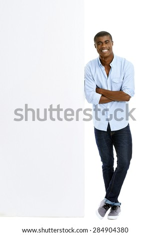 casual man with blank advertising board isolated on white - stock photo