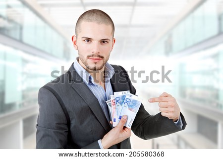 casual man with lots of money at the office - stock photo