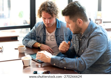 Casual meeting in a Coffee Shop - stock photo