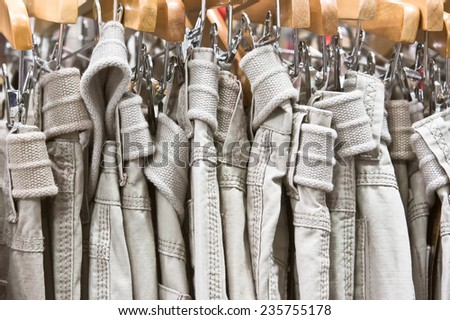 Casual men's trousers in a shop - stock photo