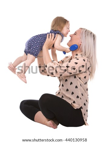 casual mother sitting with her daugher on white isolated background - stock photo