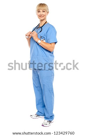 Casual portrait of a confident physician standing sideways. Isolated over white. - stock photo