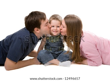 Casual portrait of happy young family of three isolated on white background