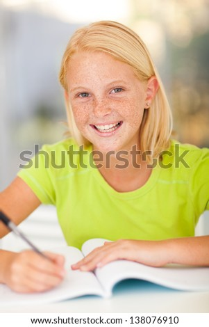 casual preteen girl studying at home - stock photo