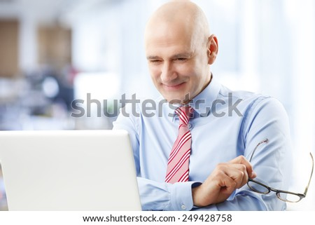 Casual sales man sitting in front of computer while sitting at office. Business people.  - stock photo