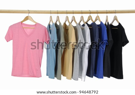 casual shirts on wooden hangers, isolated on white. - stock photo