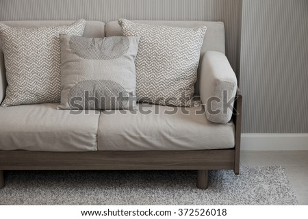 Casual sofa with pillows in a room
