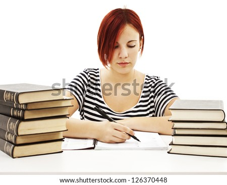 Casual student doing her homework. Isolated on white background. - stock photo
