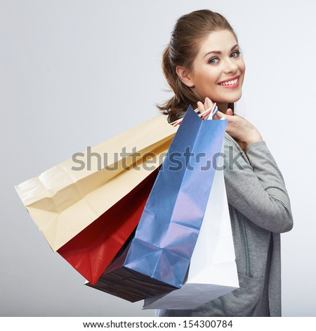 Casual style woman hold shopping bag. Studio female isolated portrait on white background. - stock photo
