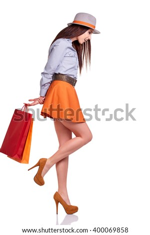 Casual style woman hold shopping bag. Studio female isolated portrait on white background.