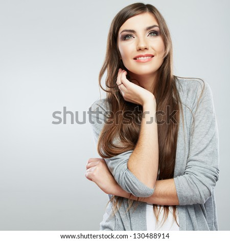 Casual style woman portrait . Smiling girl standing against studio background .