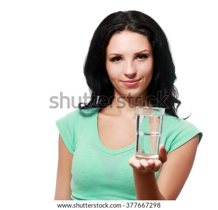 Casual style young woman posing on isolated studio background