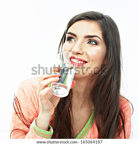 Casual style young woman posing on isolated studio background, hold water glass. Beautiful girl portrait.