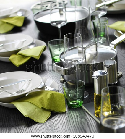 Casual table setting with shades of green and grey - stock photo