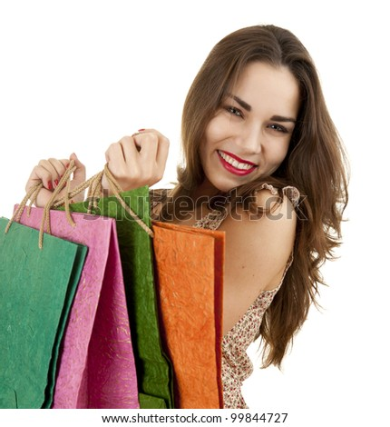casual teenage gir with shopping bags, white background