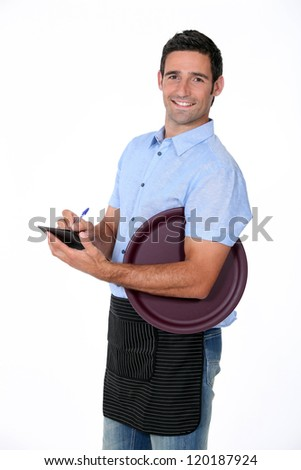 Casual waiter with tray and notepad - stock photo