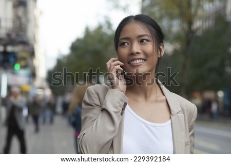 Casual woman and mobile phone - stock photo