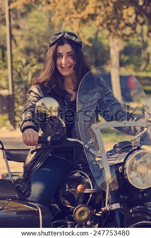 Casual woman at custom sidecar bike with vintage filter an natural light - stock photo