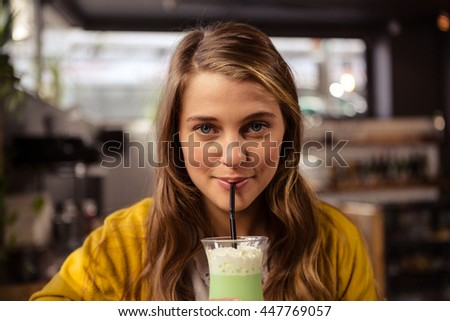 Casual woman drinking a cocktail in the restaurant