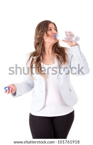 Casual woman drinking water - stock photo