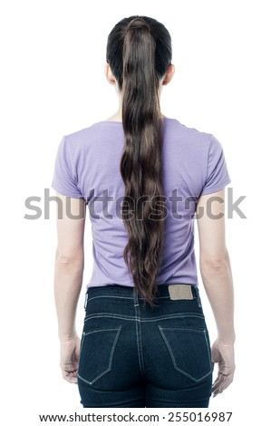 Casual woman facing the wall, from back.