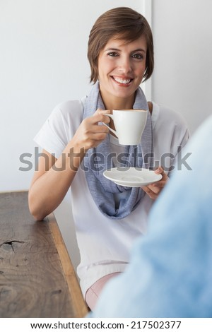 Casual woman having a coffee with friend at the coffee shop