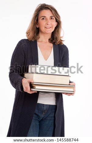 Casual woman holding  a pile of books - stock photo