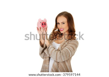 Casual woman holding piggy-bank. - stock photo