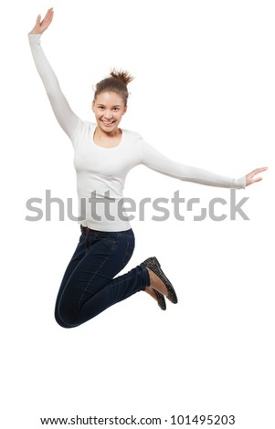 Casual woman jumping in joy ? isolated over a white background