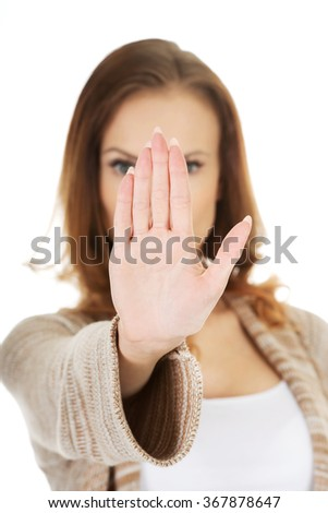 Casual woman making stop gesture.