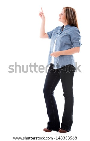 Casual woman pointing to the side - isolated over a white background - stock photo