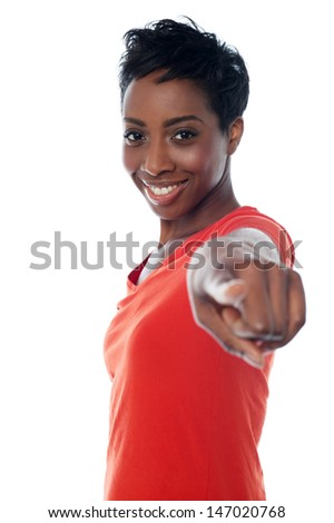 Casual woman pointing towards you - stock photo