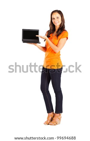casual woman presenting laptop - stock photo