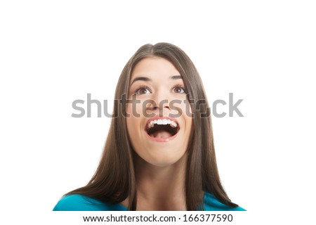 Casual woman's face looking. Isolated on white.