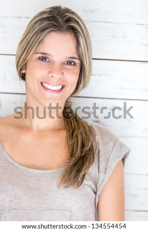 Casual woman smiling and looking very happy - stock photo