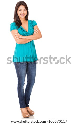 Casual woman standing isolated over a white background