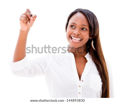 Casual woman writing on an imaginary screen - isolated over white background - stock photo